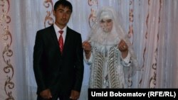 Newly married Anvar and Nargiz after their traditional wedding. The Tajik government is wary of a revival of Muslim customs, fearing the rise of radical Islam and the return of young people who went to fight in Syria.