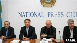 Asylbek Kozhakhmetov and Bolat Abilov (left and second from left) at a press conference in October
