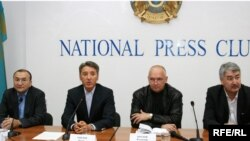 Asylbek Kozhakhmetov and Bolat Abilov (far left and second from left) at a press conference in October