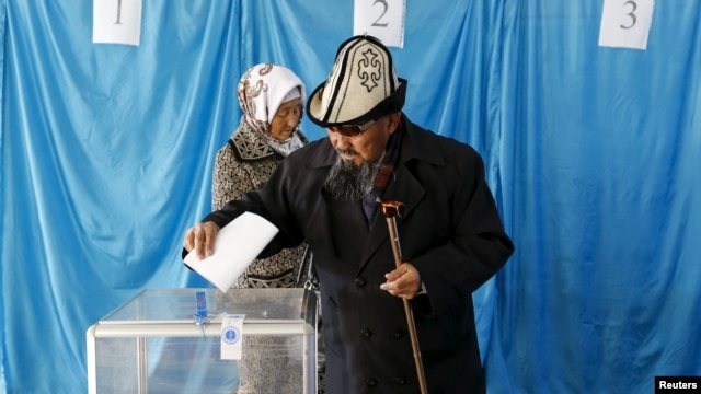 Kazakhs vote during snap parliamentary elections in the southern village of Toretam on March 20.