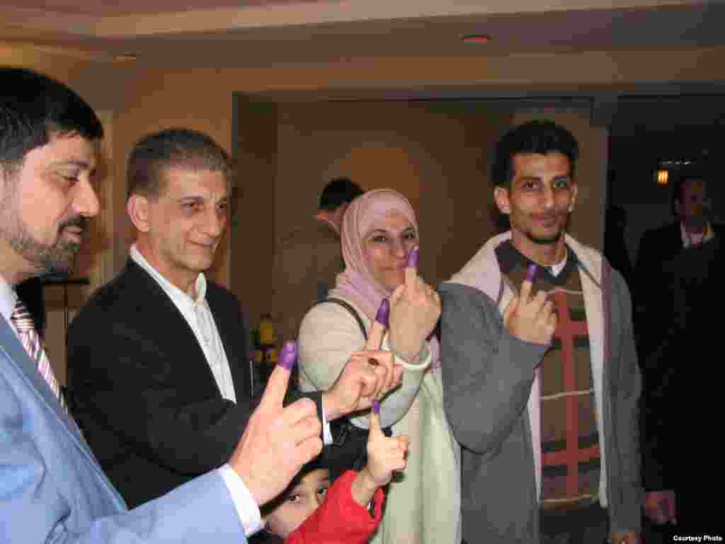 Iraqi expat voters show their ink-stained fingers after casting their ballots in Virginia. (Photo: Radio Free Iraq)