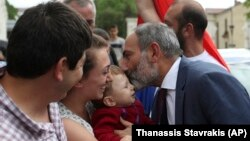 NAGORNO-KARABAKH -- Armenia's Prime Minister Nikol Pashinian kisses a baby after a news conference in Stepanakert, May 9, 2018. Nagorno-Karabakh