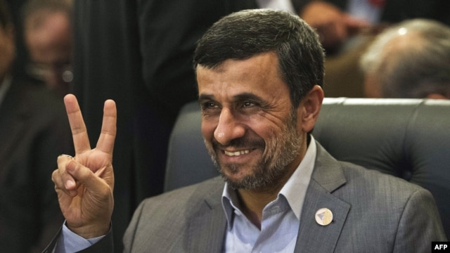 Iranian President Mahmud Ahmadinejad flashes the victory sign as he attends the 12th summit of the Organization of Islamic Cooperation in Cairo on February 6.
