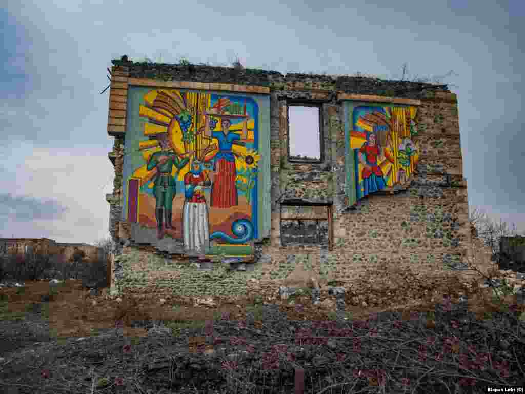 A Soviet-era mural still stands amid the city ruins. Lohr says he was told to move quickly to avoid Azerbaijani snipers that sometimes worked in the surrounding areas.