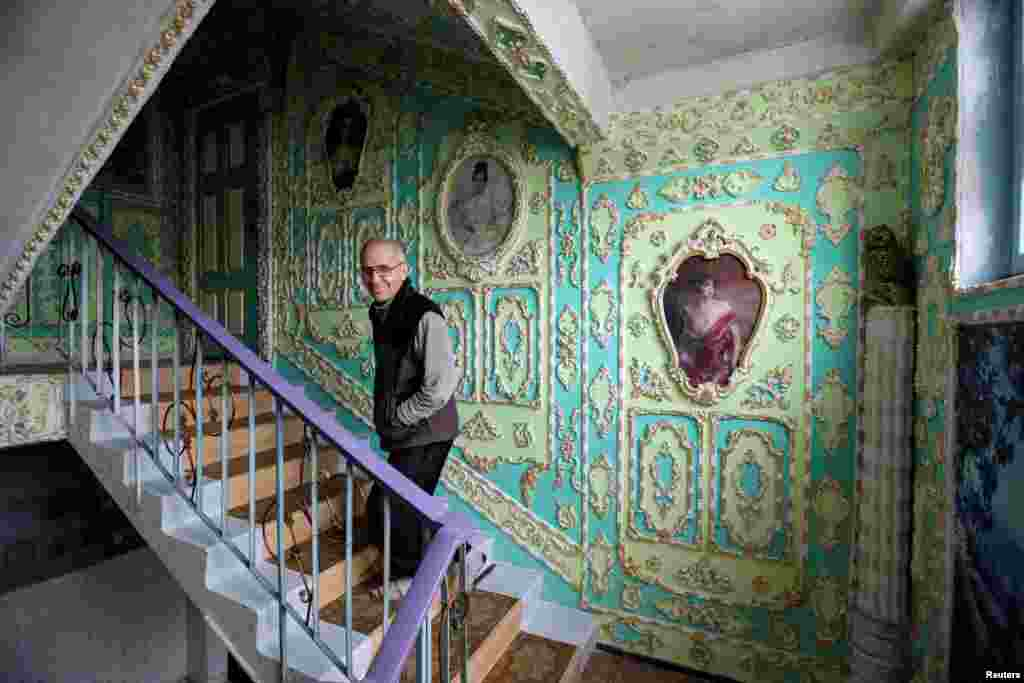 A stairwell is seen in an apartment block that one of its residents, 65-year-old Volodymyr Chayka, has spent the last five years decorating by himself in an elaborate, old-fashioned style, in a residential district of Kyiv. (Reuters/Gleb Garanich)
