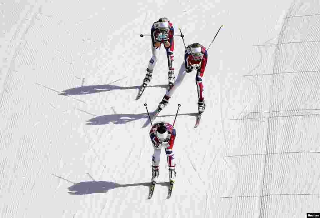 Norway's Marit Bjoergen (bottom), Kristin Stoermer Steira, and Therese Johaug (top) compete during the women's cross-country 30-kilometer mass start event. All three won medals. (Reuters/Carlos Barria)