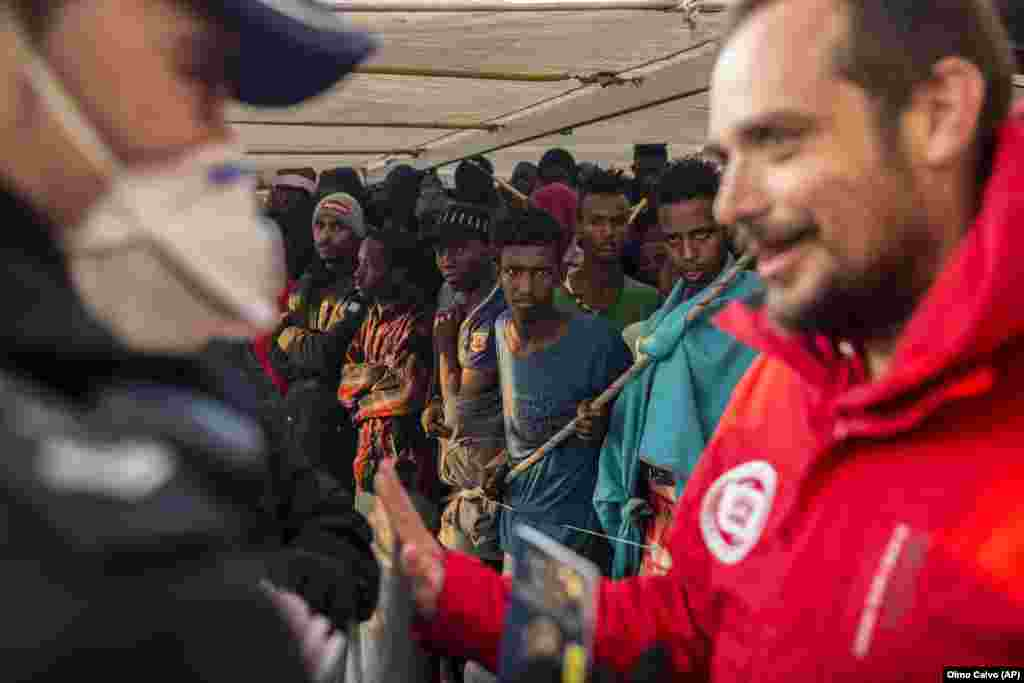Migrants gather on the deck of the Spanish NGO Proactiva Open Arms vessel after being rescued in the central Mediterranean Sea, before disembarking at the port of Crinavis in Algeciras, Spain. Other European countries such as Italy, Malta, and Greece had closed their ports to the ship. Only Spain admitted entry. (AP/Olmo Calvo)