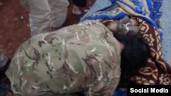Uzbek militant commander Salahuddin buries his 16-year-old son.