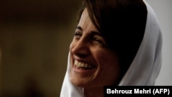 Iranian lawyer and rights defender Nasrin Sotoudeh smiles at her home in Tehran, September 18, 2013
