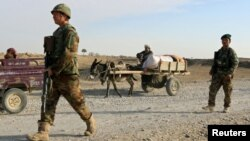 FILE: Afghan soldiers at a checkpoint in Jawzjan