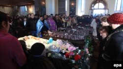 Mourners attend a funeral service for the slain family in the city of Gyumri on January 15.