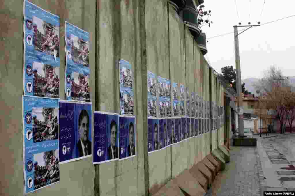 Posters glued to concrete barriers in the Afghan capital, Kabul.