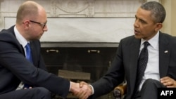 US President Barack Obama (right) shakes hands with Ukrainian Prime Minister Arseniy Yatsenyuk during meetings in the Oval Office of the White House in Washington, D.C. on March 12.