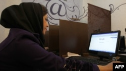 A woman surfs the Internet at a cybercafe in central Tehran.