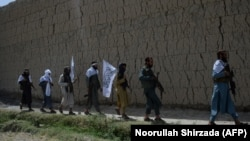 FILE: Afghan Taliban fighters in eastern Afghanistan.