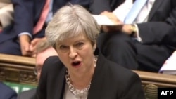 British Prime Minister Theresa May speaks in the British Parliament on April 19.