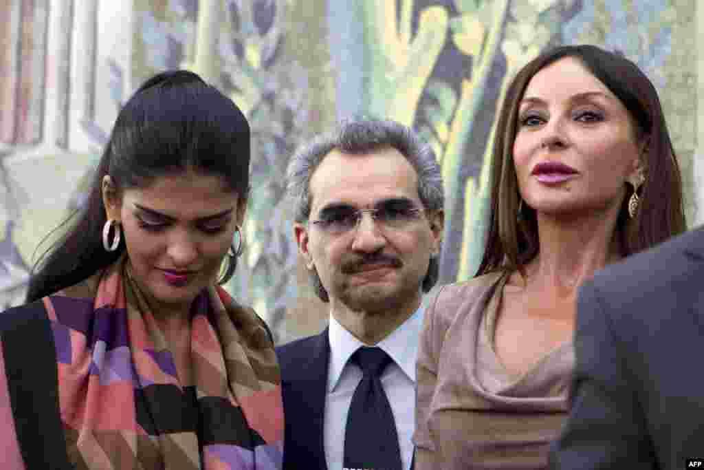 Saudi billionaire Prince Waleed bin Talal (center), his wife Princess Amira al-Tawil (left), and Azerbaijani First Lady Mehriban Aliyeva at the exhibit.