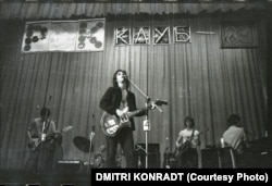 """Mikhail Vasilyevich (""""Mike"""") Naumenko and his band Zoopark play in the main hall of the Leningrad Rock Club in 1983. Known for his bitingly satirical lyrics, Naumenko played a significant role in helping to adapt the Western rock tradition for Russian audiences. Regarded today as one of the country's most influential lyricists, he died of a reported brain hemorrhage in 1991 at the age of 36."""