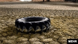 A tire lies on a dried-up section of Lake Urmia in northwestern Iran.