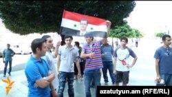 Armenia - Syrian Armenians demonstrate outside the prime minister's office in Yerevan, 19Jul2012.