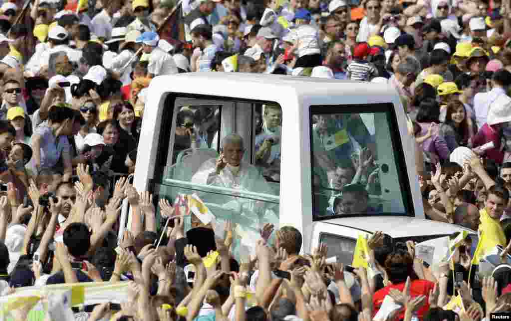 Pope Benedict waves as he arrives to lead a solemn mass in Zagreb, Croatia, on June 5, 2011.