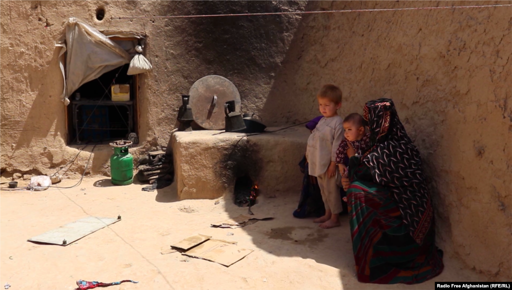 Shukrullah's son and wife in their rented house in Jawzjan's capital, Sheberghan