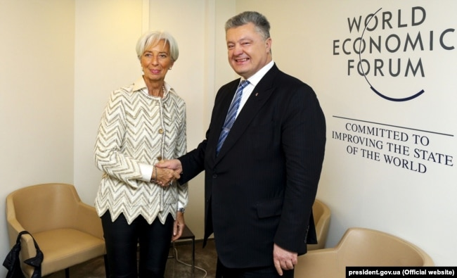 Президент України Петро Порошенко і директор-розпорядник МВФ Крістін Лаґард. Давос, 23 січня 2019 року