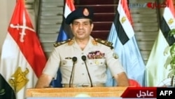 Egyptian Defense Minister Abdel Fattah al-Sisi announces the army's road map for Egypt's political future on state television on July 3.