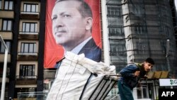 A huge portrait of Turkish President Recep Tayyip Erdogan on Taksim Square in Istanbul