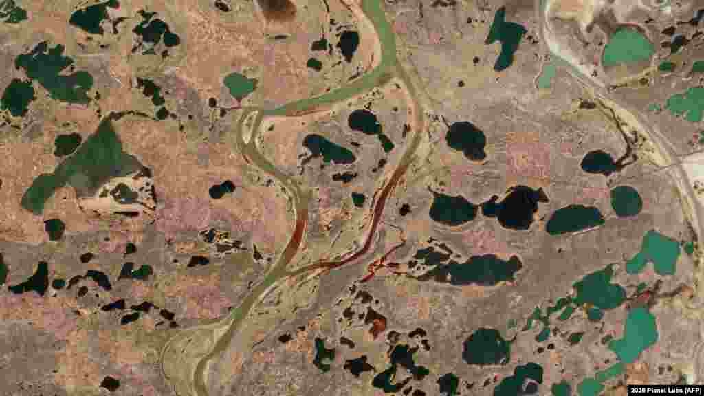 An aerial view of the large diesel spill in the Ambarnaya River outside Norilsk in the Russian Arctic taken on June 4. Environmentalists say the spill, which took place on May 29, is the worst such accident ever to occur in the Arctic region. (AFP/ © 2020 Planet Labs Inc)