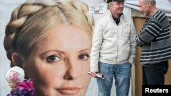 Supporters of jailed former Prime Minister Yulia Tymoshenko chat in a protest tent camp in central Kyiv on October 7.