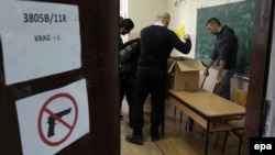 Kosovar election-committee members prepare for voting at a polling station Mitrovica on November 3.