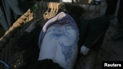 A Taliban militant who was killed during a gun battle in Peshawar was found to have an elaborate tattoo on his back.