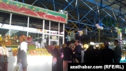 Customers queue for fresh meat in Ashgabat.