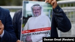 A demonstrator holds picture of Saudi journalist Jamal Khashoggi during a protest in front of Saudi Consulate in Istanbul last month.
