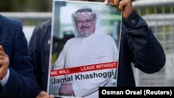 A demonstrator holds a picture of Saudi journalist Jamal Khashoggi during a protest in front of Saudi Arabia's consulate in Istanbul earlier this month.