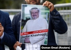 A demonstrator holds a picture of Saudi journalist Jamal Khashoggi during a protest in front of the consulate in Istanbul last month.