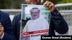 Istanbul, Turkey - A demonstrator holds picture of Saudi journalist Jamal Khashoggi during a protest in front of Saudi Arabia's consulate in Istanbul, October 5, 2018. REUTERS/Osman Orsal