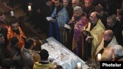 Armenia - A requiem service for 6-month-old Seryozha Avetisian at Gyumri's Surp Nshan Church, 20Jan2015.
