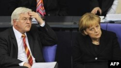 German Foreign Minister Frank-Walter Steinmeier and Chancellor Angela Merkel at a Bundestag debate in October over German troops' mandate in Afghanistan.