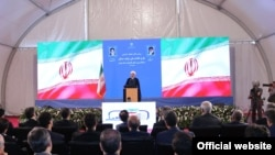 Iran--In this photo released by the official website of the office of the Iranian Presidency, President Hassan Rouhani speaks in a conference in Tehran, Iran, Tuesday, Aug. 27, 2019.