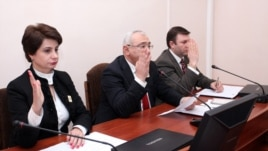 Armenia - Central Election Commission (CEC) Chairman Tigran Mukuchian (C) and other members of the CEC approve the final results of the February 18 presidential election, Yerevan, 25Feb2013.