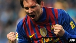 مهاجم برشلونة ليونيل ميسي بعد تسجيله هدفاً في إحدى مباريات الدوري الإسباني