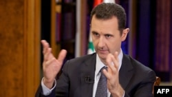 Syrian President Bashar al-Assad speaking during a September 23 interview in Damascus.