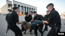 Police break up the demonstration protesting Russian troops' presence.