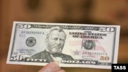 Официальный курс доллара ЦБ на завтра составил 26 рублей 91 копейку
