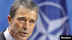"NATO Secretary-General Anders Fogh Rasmussen: ""We will exert this pressure as long as necessary."""