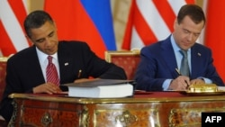 U.S. President Barack Obama (left) and his Russian counterpart, Dmitry Medvedev, sign the New START treaty in Prague on April 8, 2010.