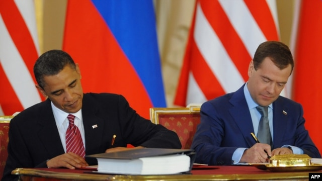 U.S. President Barack Obama (left) and his Russian counterpart Dmitry Medvedev sign the initial treaty in Prague in April.