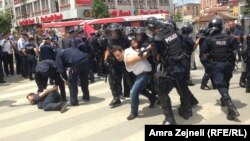 Riot police used pepper spray to disperse the crowd and tried to push it back to clear the entrance to parliament.